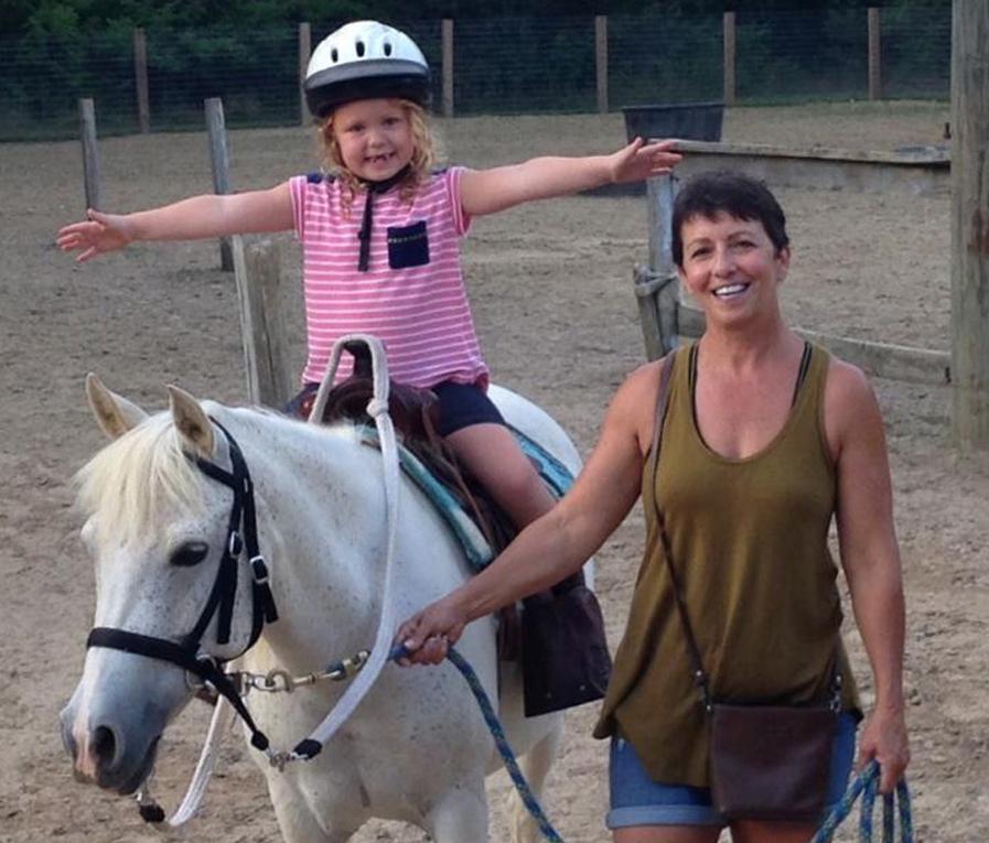 Child on white pony